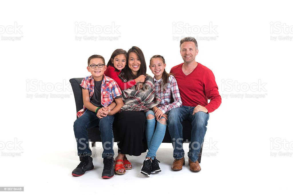 Family Sitting On Couch stock photo