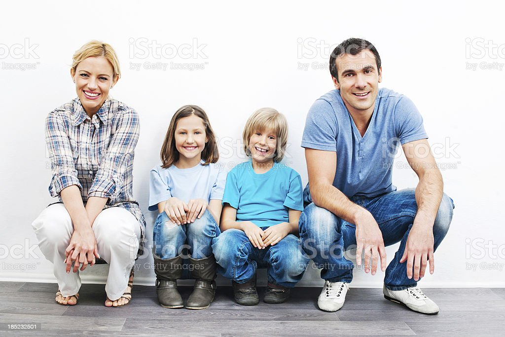 Family sitting on floor at new home. royalty-free stock photo