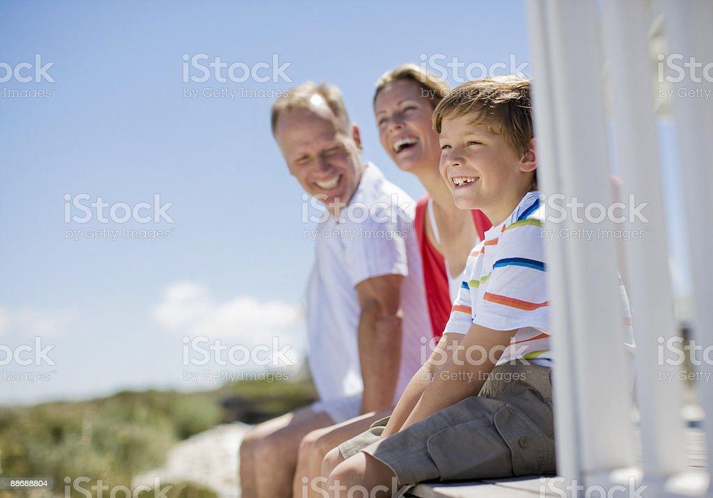 Family sitting on pier royalty-free stock photo