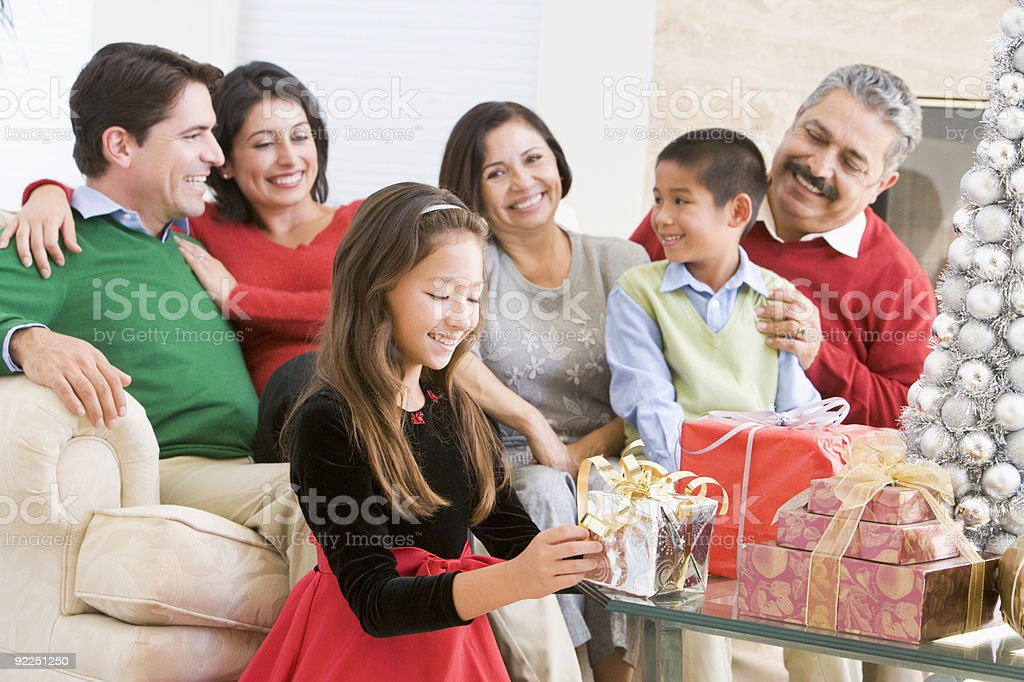 Family Sitting On Sofa In Front Of Christmas Presents royalty-free stock photo