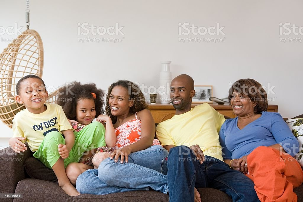Family sitting on sofa royalty-free stock photo