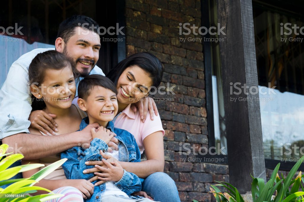 Family sitting outside their house royalty-free stock photo