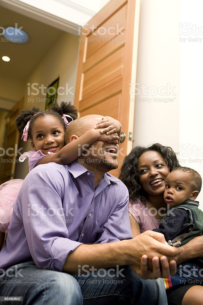 Family sitting together in play room royaltyfri bildbanksbilder