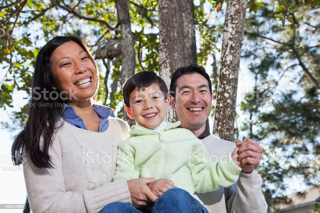 Family sitting under trees royalty-free stock photo