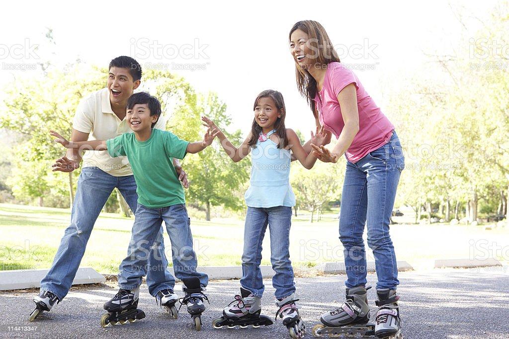 Family Skating In Park stock photo