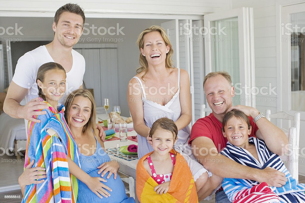Family smiling after enjoying swimming stock photo