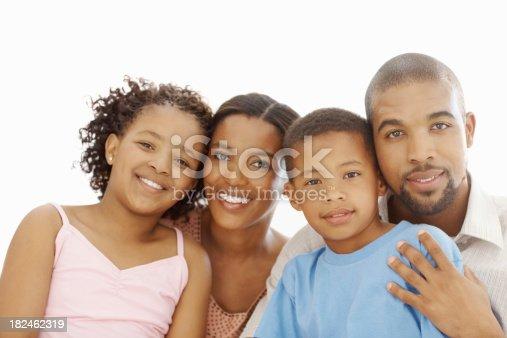 1126155137 istock photo Family smiling against white background 182462319