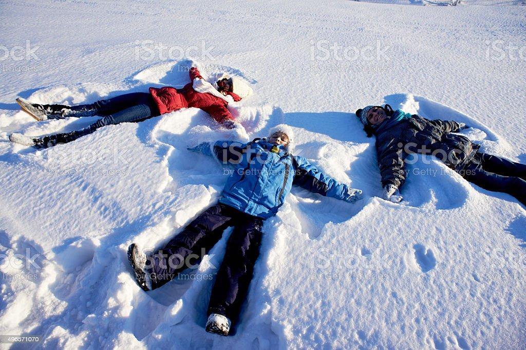 Family snow angels stock photo
