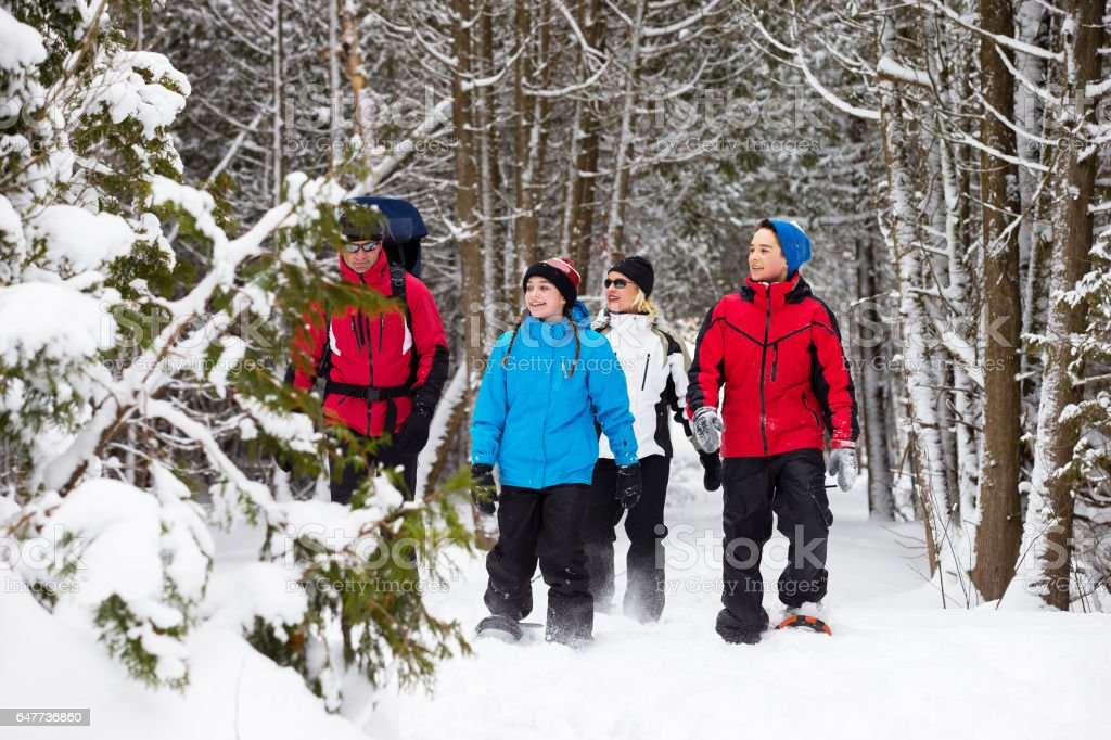 Family snowshoes in snow in Canada stock photo