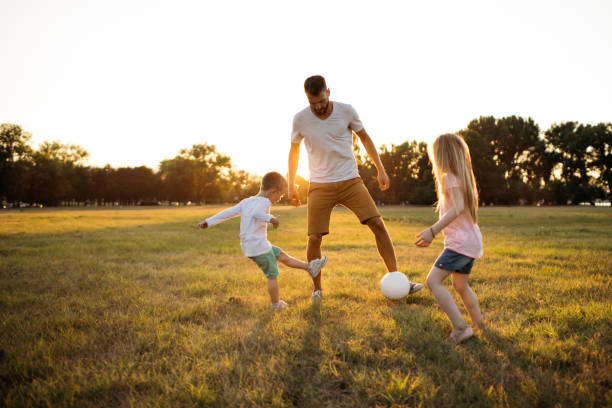 Family soccer game stock photo
