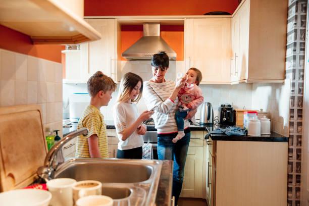 Family Socialising in the Kitchen stock photo