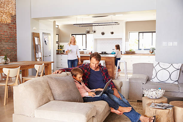 family spending time together at home - family room stock photos and pictures