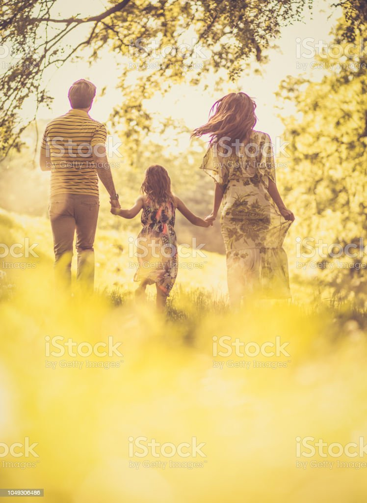 Family spending time together outside. Spring season. stock photo