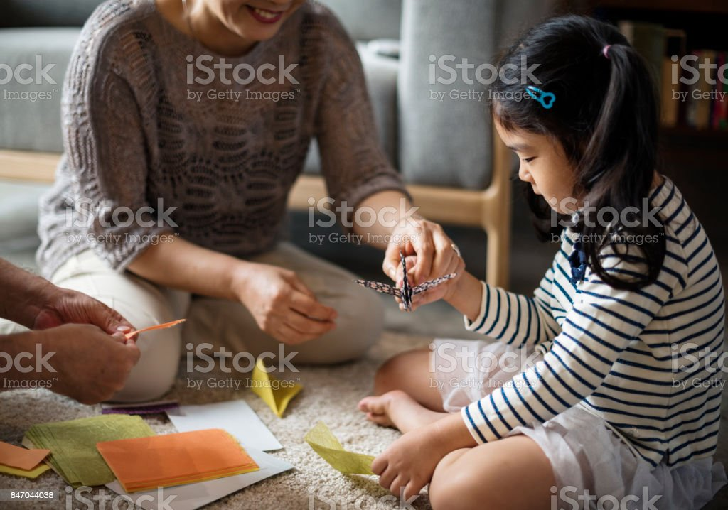 Family spenting time together at home stock photo