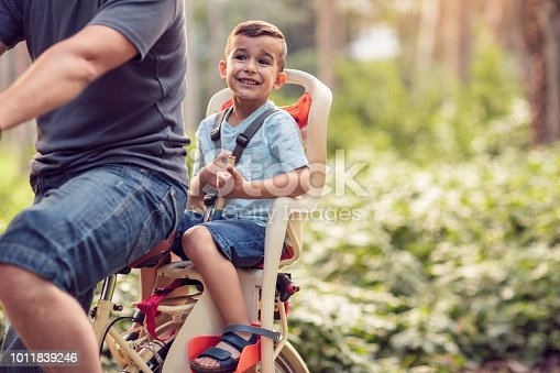 istock Family sport and healthy lifestyle- Happy boy on bicycle in park 1011839246