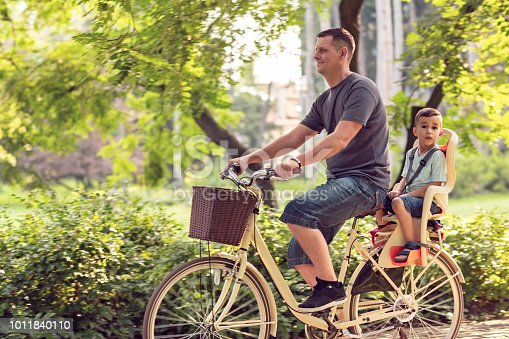 istock Family sport and healthy lifestyle- Happy boy on bicycle in park 1011840110