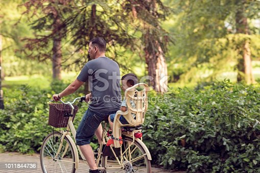 istock Family sport and healthy lifestyle- Happy boy on bicycle in park 1011844736