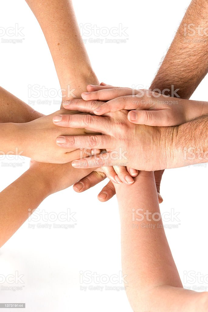 Family Stacks Hands In Teamwork royalty-free stock photo