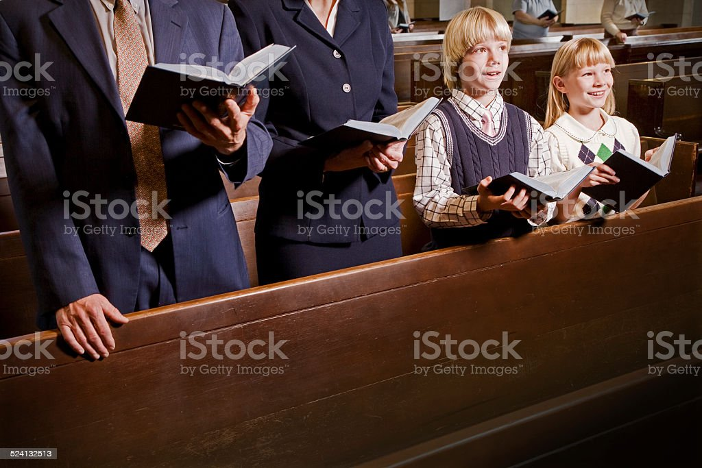 Family Standing and Singing in Church stock photo