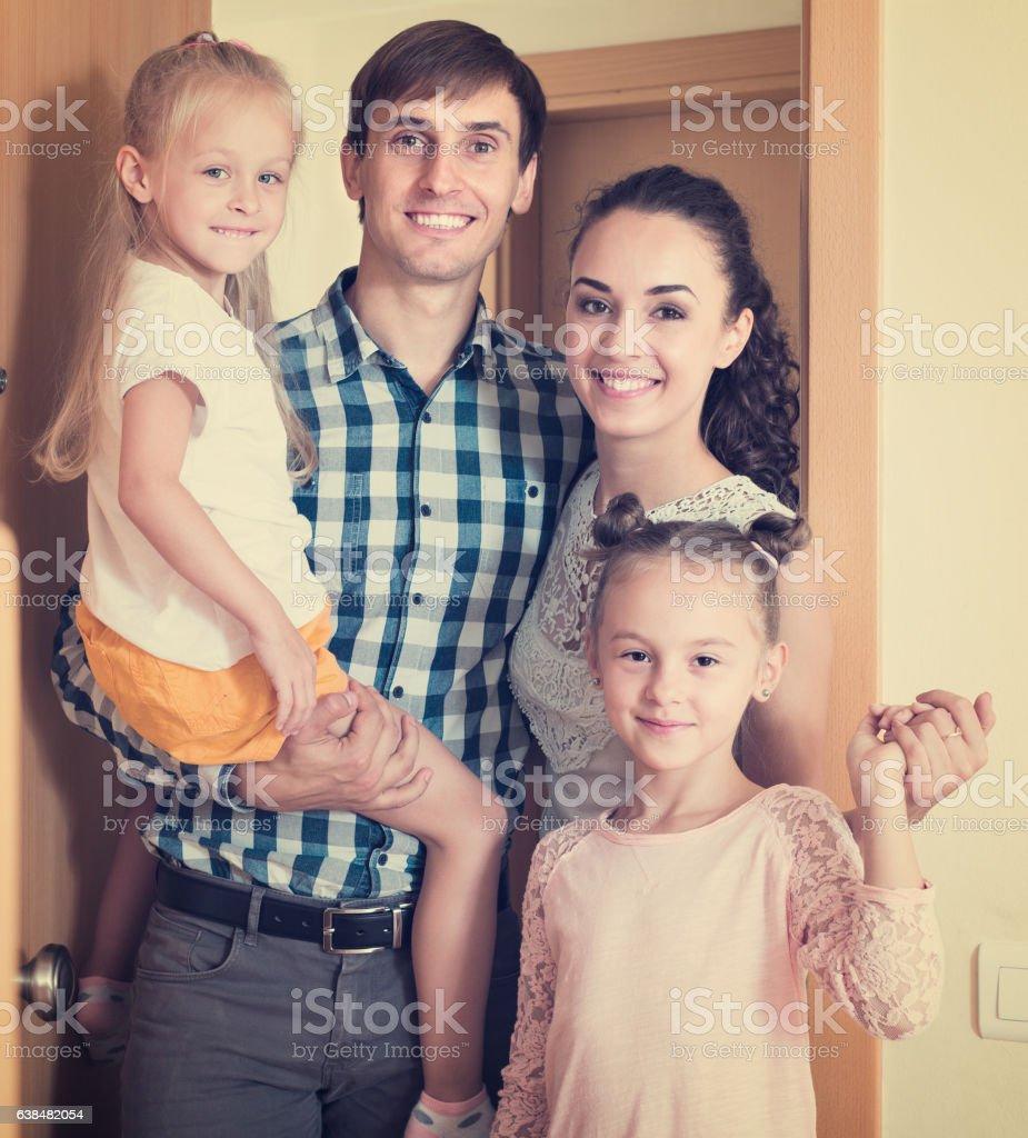 family standing at doorway stock photo