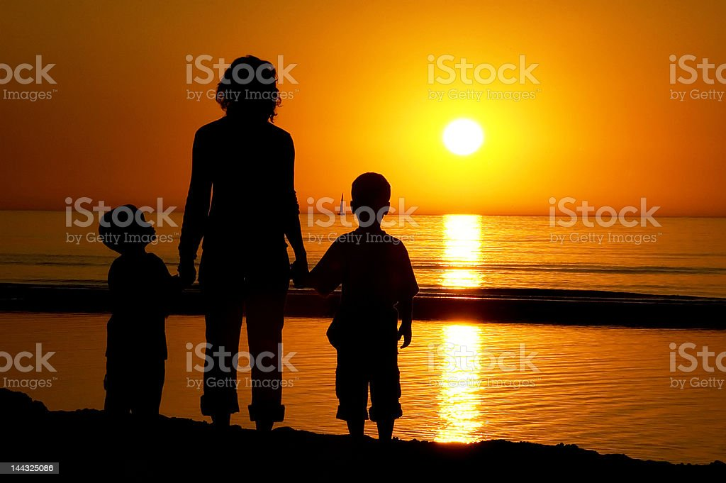 Family Standing At The Beach royalty-free stock photo