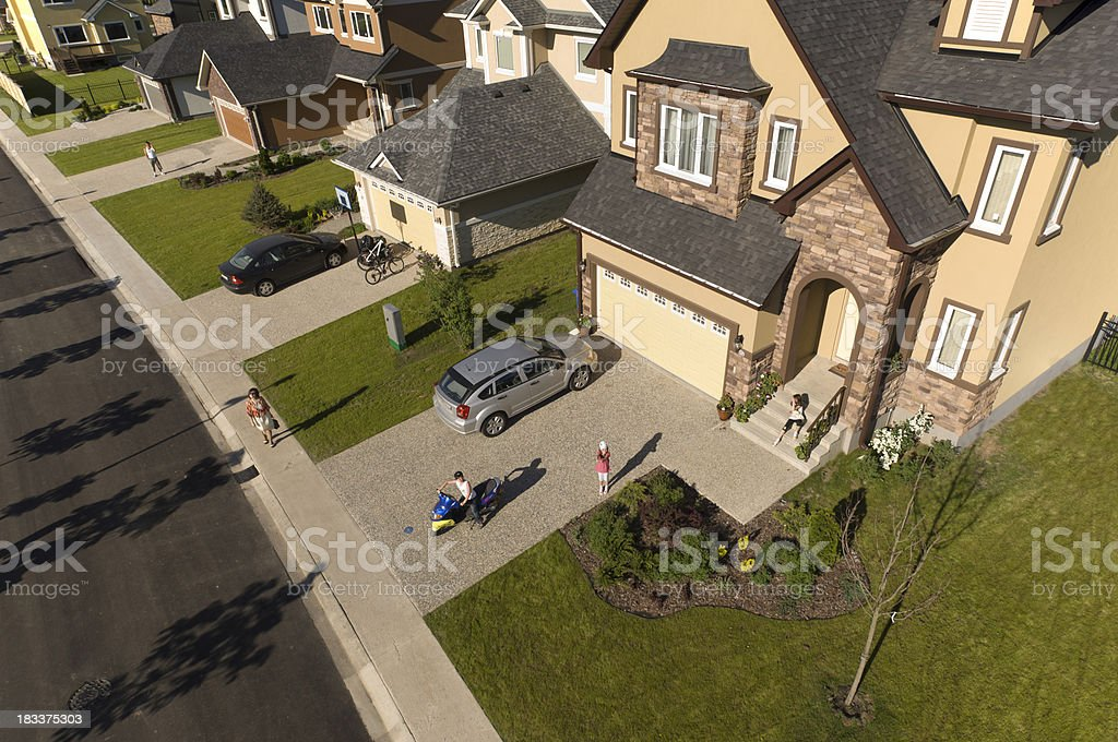 Family standing in front of their home. stock photo