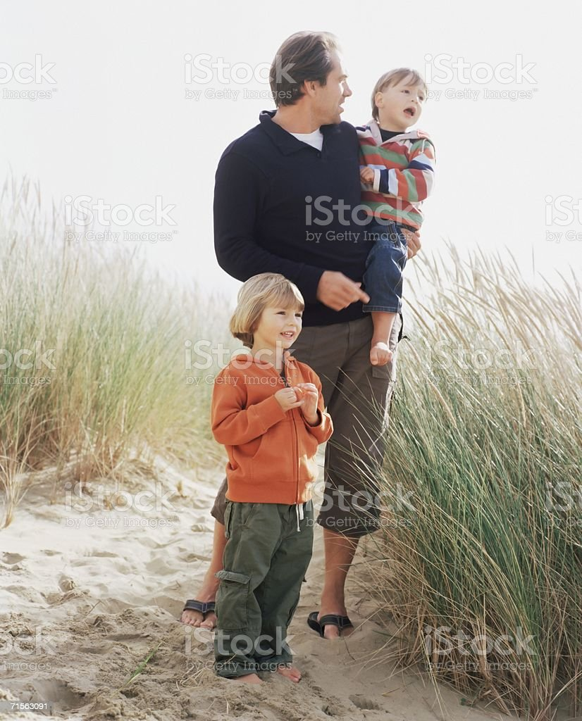 Family standing on a dune royalty-free stock photo