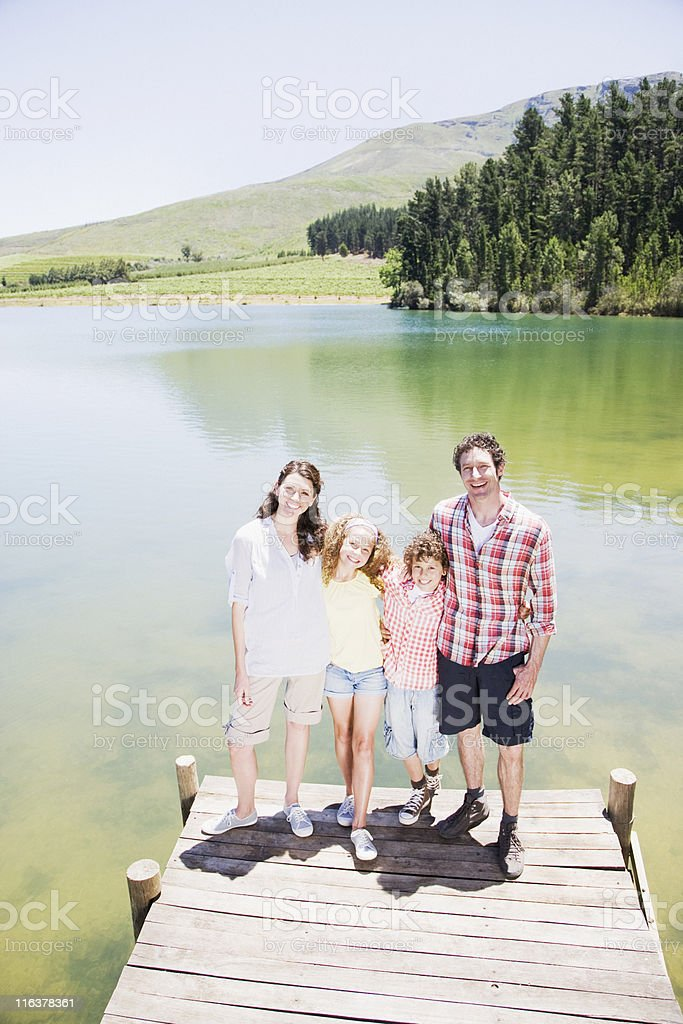 Family standing on dock royalty-free stock photo