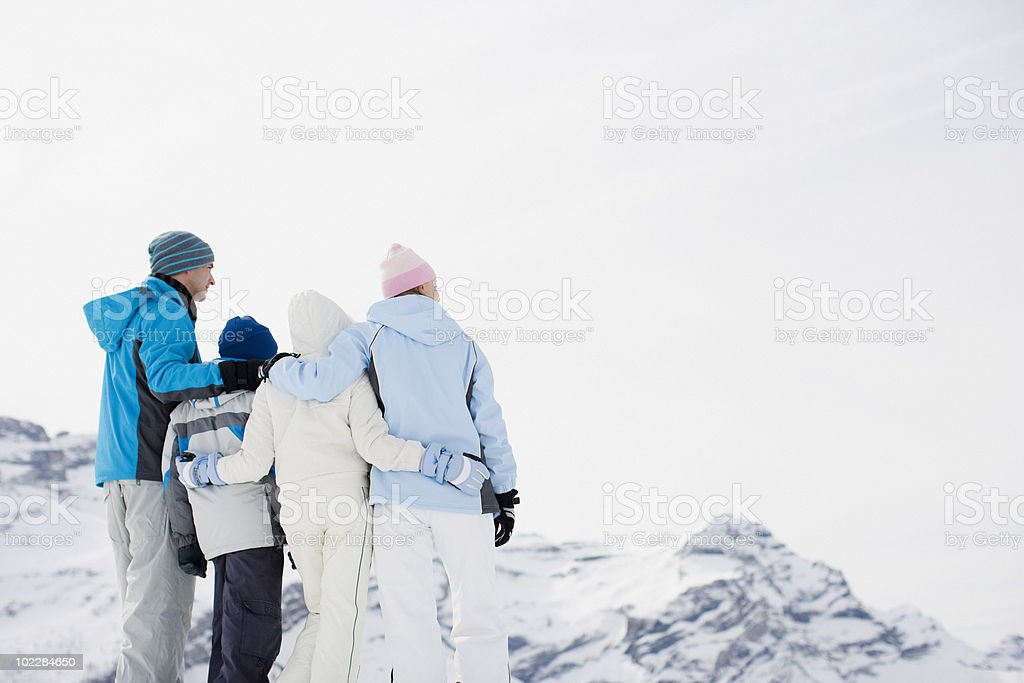 Family standing on mountain top royalty-free stock photo