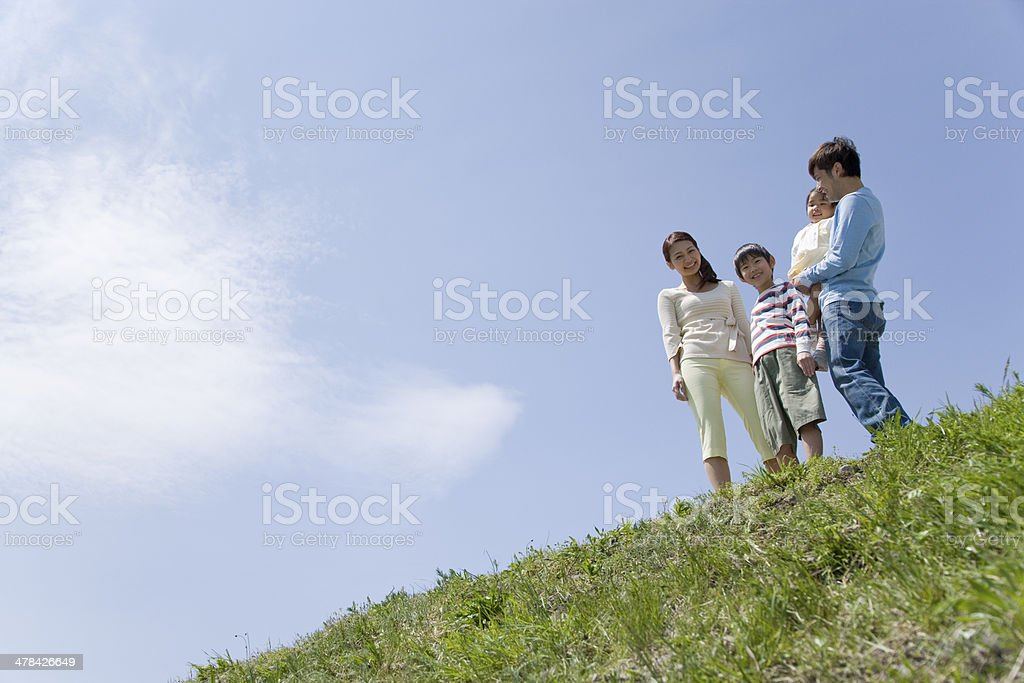 Family standing still on bank stock photo