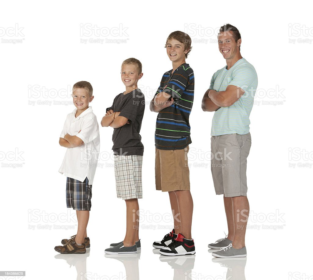 Family standing with their arms crossed stock photo