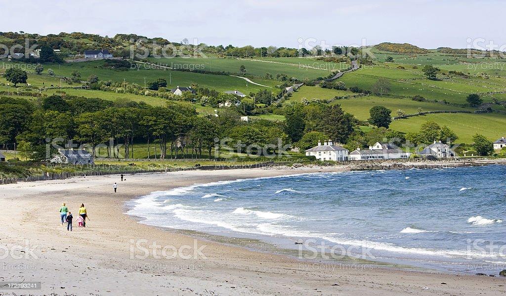 Family strolls beach stock photo
