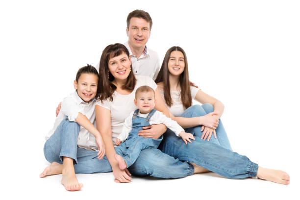 Family Studio Portrait, Happy Parents and Three Children on White stock photo