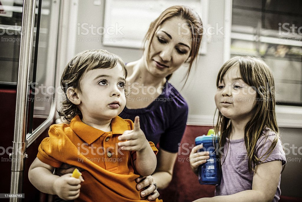 Family subway ride stock photo