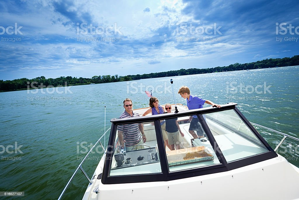 Family Summer Boating on a Lake stock photo