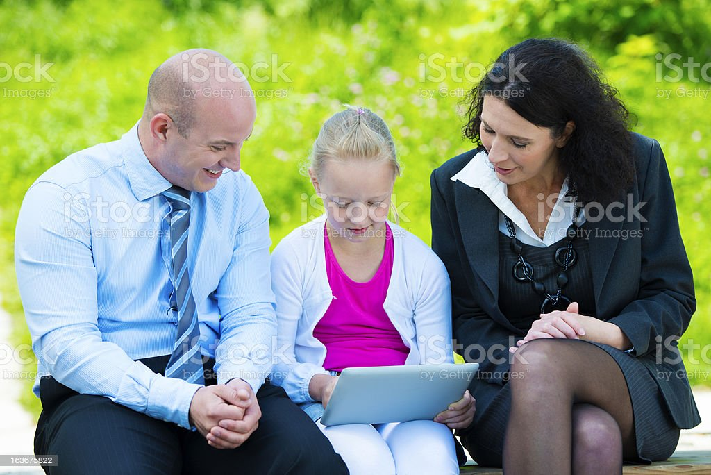Family Surfing the Net in the Park royalty-free stock photo