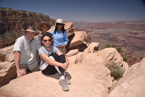 Family take a break from hiking the Grand Canyon, Arizona