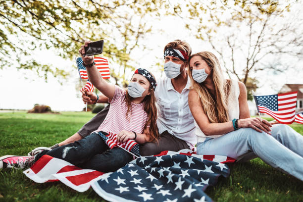 family take a selfie during the us holiday family take a selfie during the us holiday family 4th of july stock pictures, royalty-free photos & images