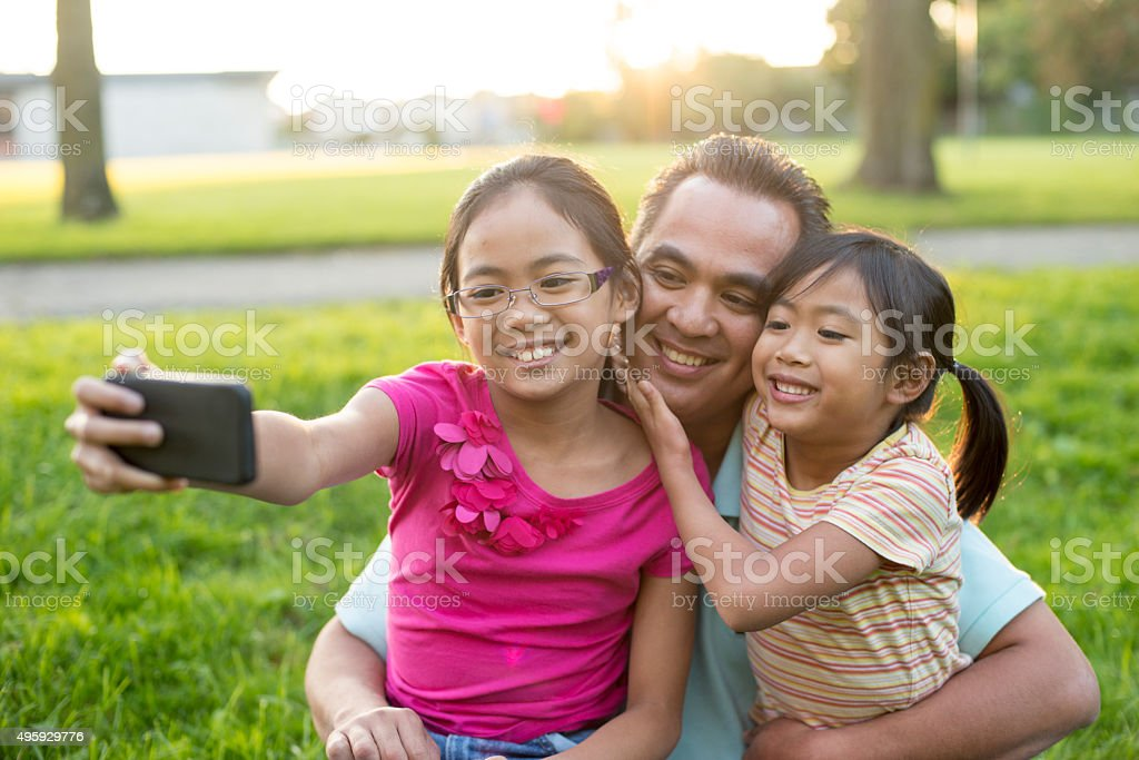 Family Taking a Selfie at the Park stock photo