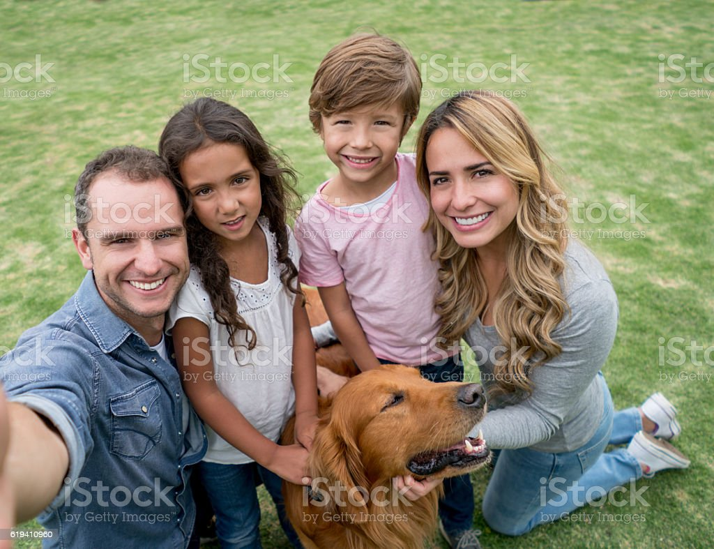 Family taking a selfie outdoors stock photo