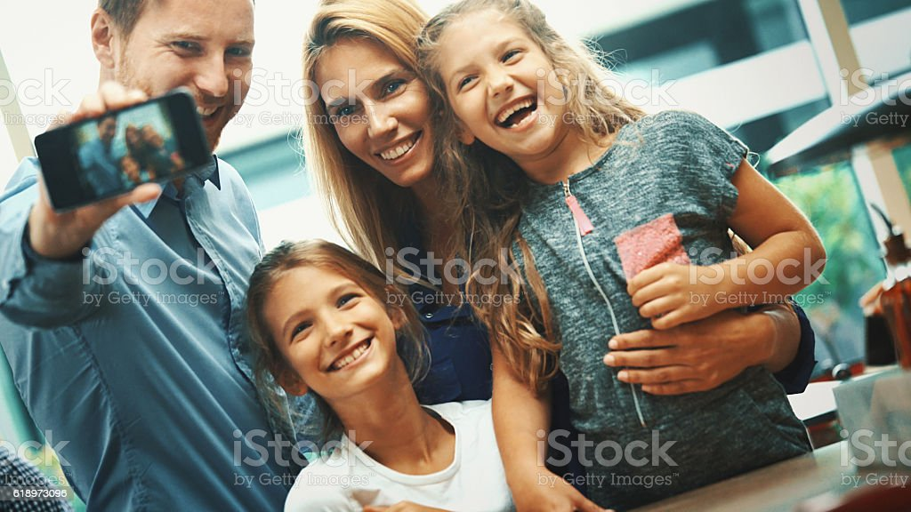 Family taking a selfie. stock photo