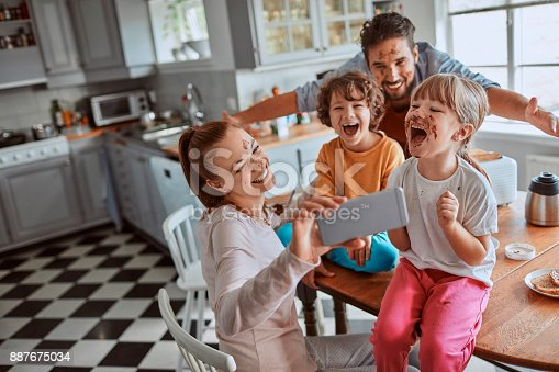894071774 istock photo Family taking a selfie 887675034