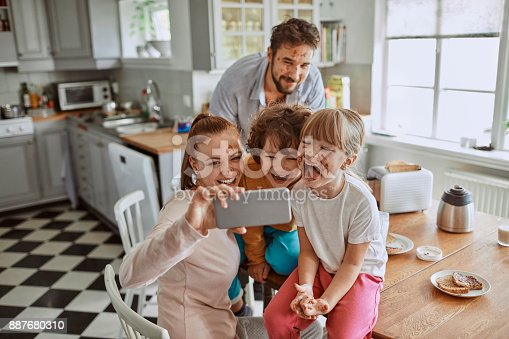 894071774 istock photo Family taking a selfie 887680310
