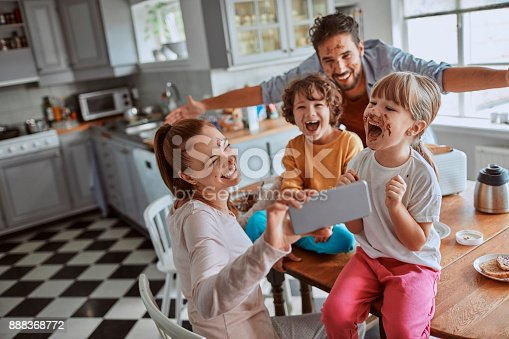 894071774 istock photo Family taking a selfie 888368772