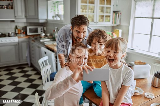 894071774 istock photo Family taking a selfie 888387600