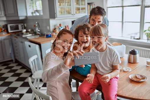 894071774 istock photo Family taking a selfie 892643656
