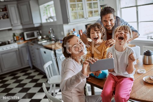 894071774 istock photo Family taking a selfie 894071774