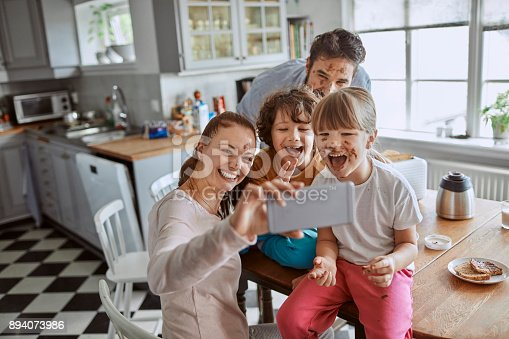 894071774 istock photo Family taking a selfie 894073986