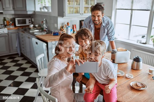 894071774 istock photo Family taking a selfie 896460978
