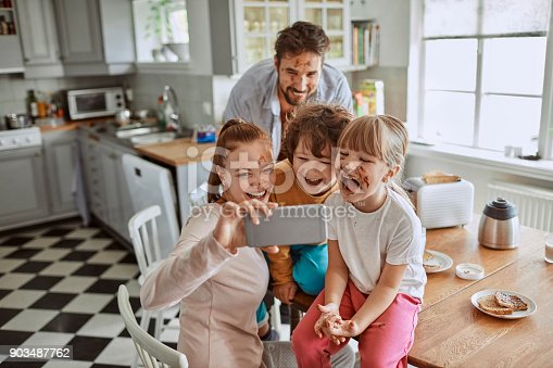 894071774 istock photo Family taking a selfie 903487762